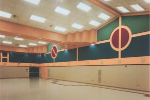 Fabric wrapped acoustic panels in multipurpose room