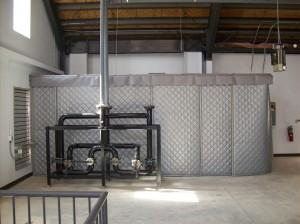 Sound curtain enclosure around vacuum pump